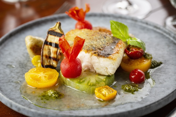 fried fish with coloured tomatoes