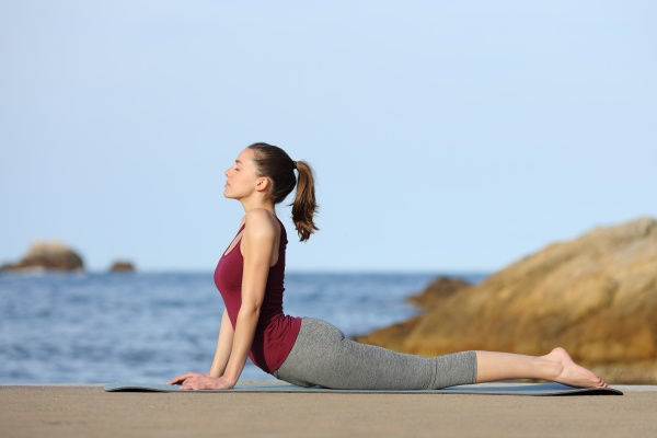 profile of a woman practicing yoga