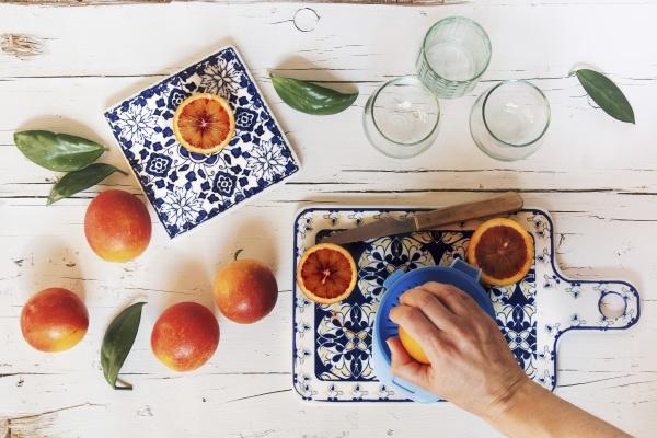 a blood orange being juiced