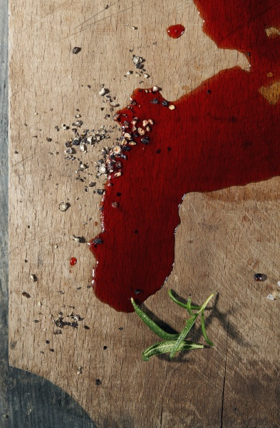blood on a wooden cutting board