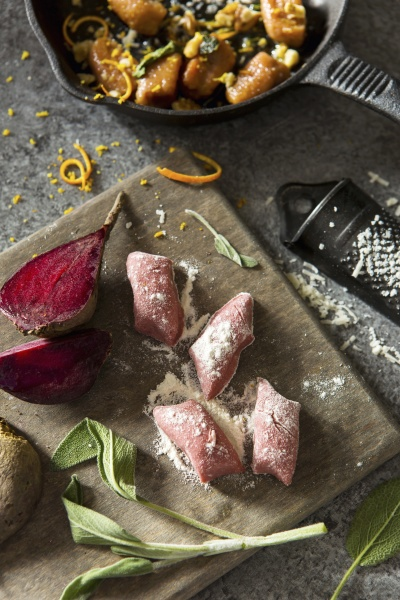 beetroot gnocchi on a chopping board