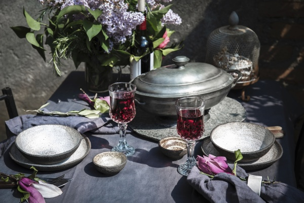 tablecloth setting with artichokes flowers and