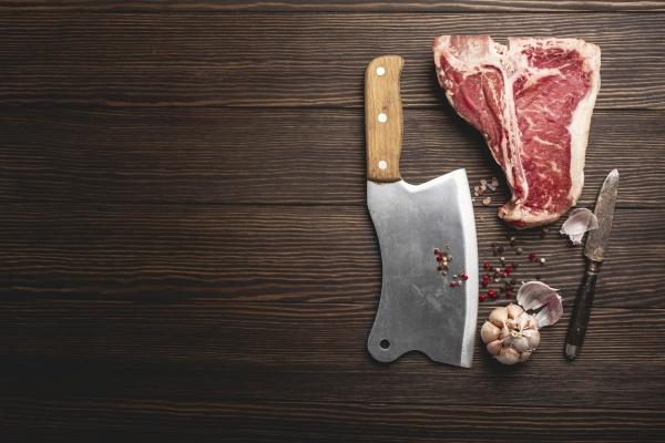 a raw t bone steak with