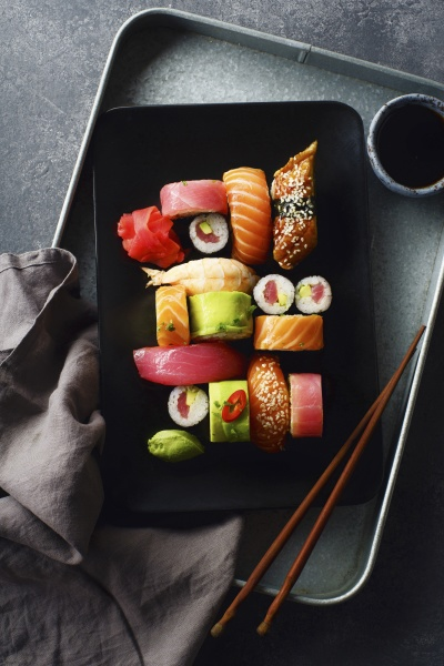 variety of sushi and rolls served