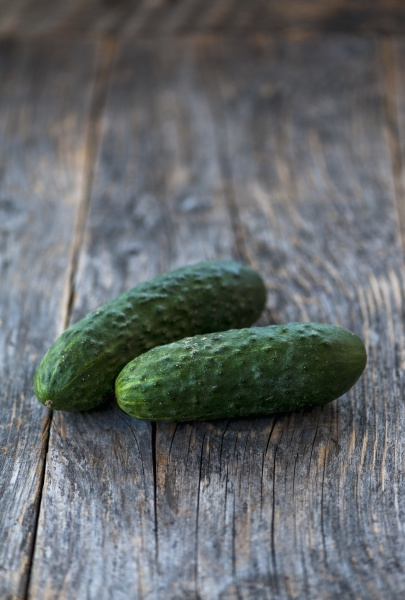 two cucumbers on a rustic background