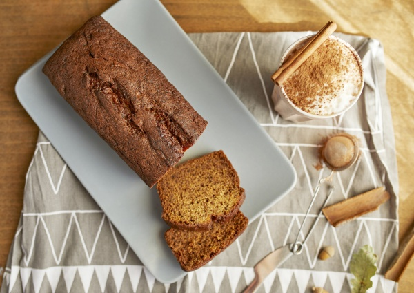 baked banana bread with a cup