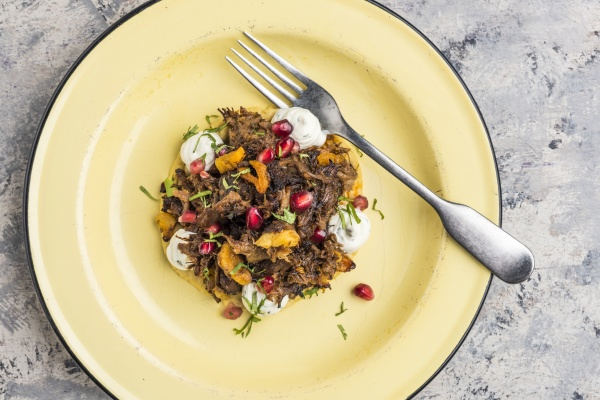 hot lamb with pomegranate seeds