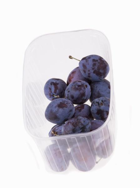 fresh plums in plastic punnet
