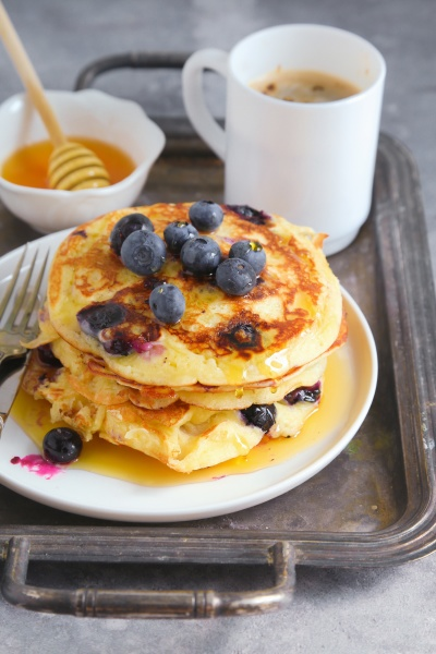blueberry pancakes served with honey and