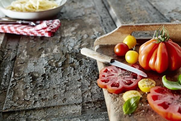 various heirloom tomatoes with salt pepper