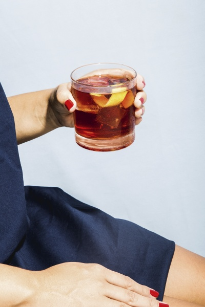 woman holding a glass of negroni