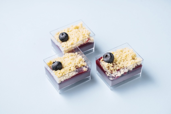 glass containers with blueberry cakes