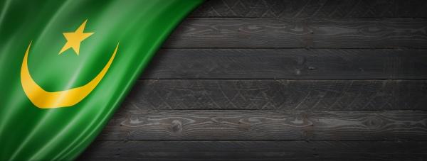 mauritania flag on black wood wall