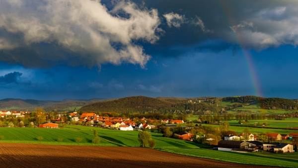 clouds and rain over the village