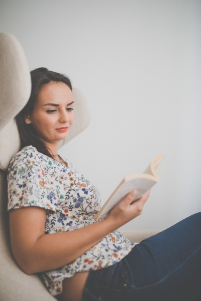 cute young woman reading a book