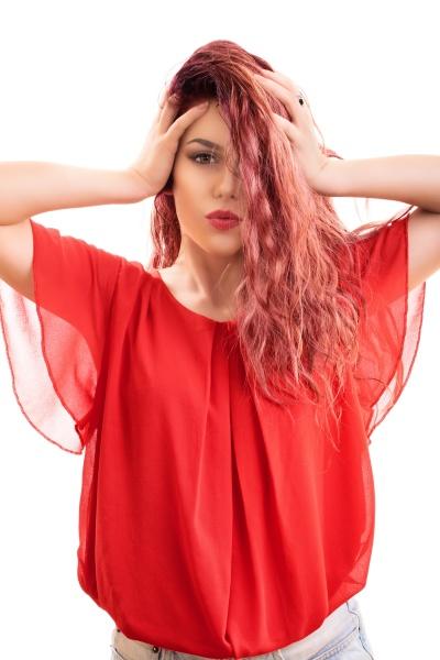 beautiful redhead sending a kiss to
