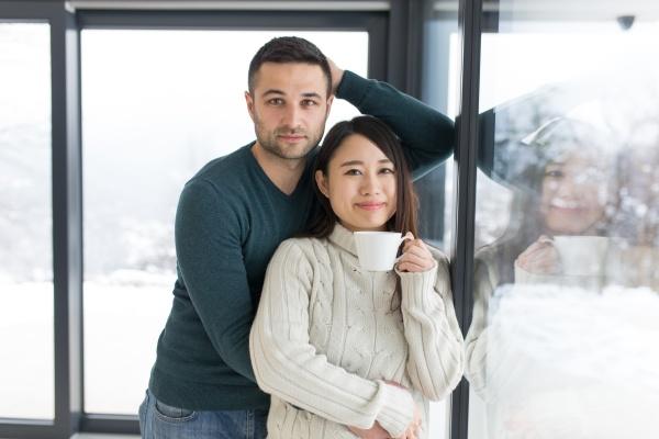 multiethnic couple enjoying morning coffee by