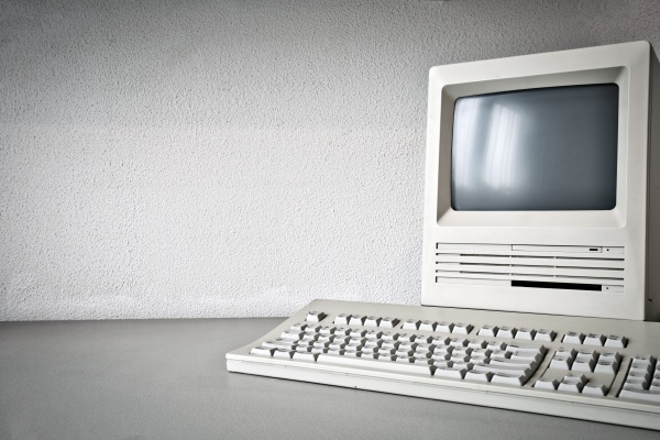 old vintage monitor and computer on