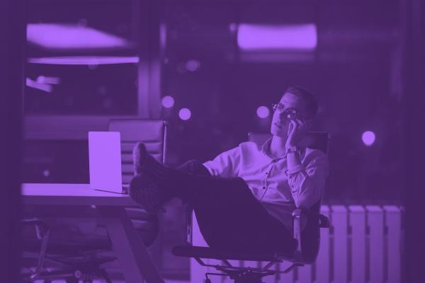 businessman using mobile phone in dark