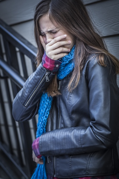 young crying teen aged girl on