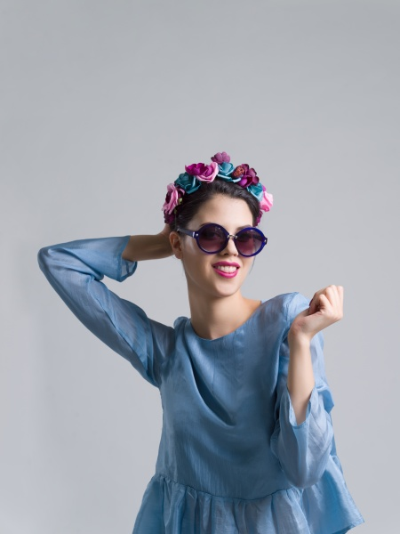 woman posing in fashionable clothes and