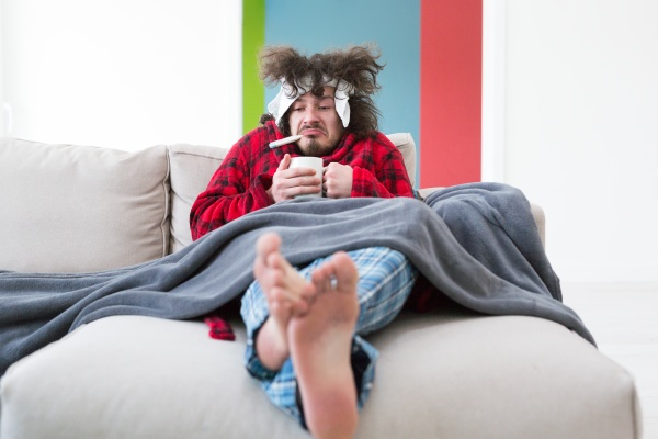young man with flu and fever