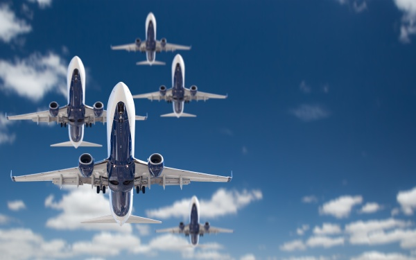 bottom view of several passenger airplanes