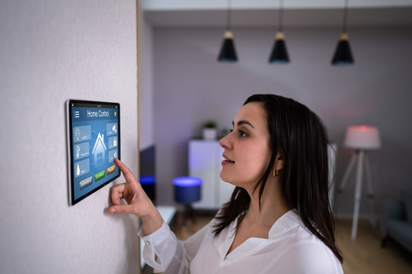 women using home automation and camera