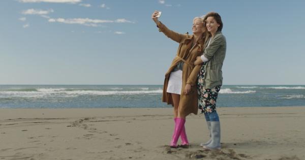 girls having time and taking selfie