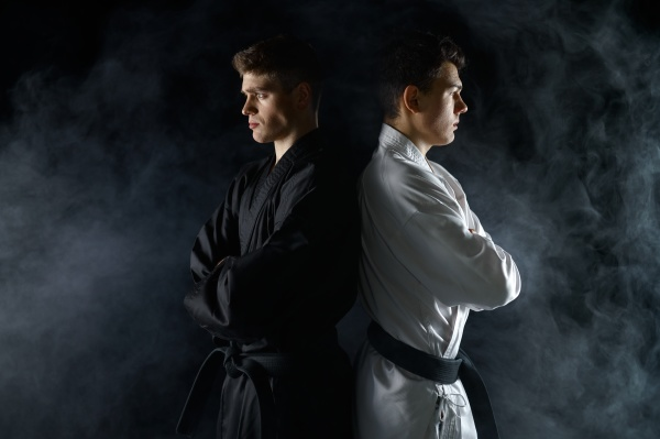 two male karatekas in white and