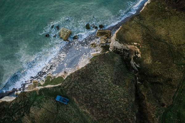 aerial view of car on cliff