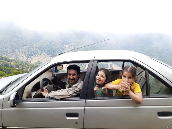 family at car travel concept