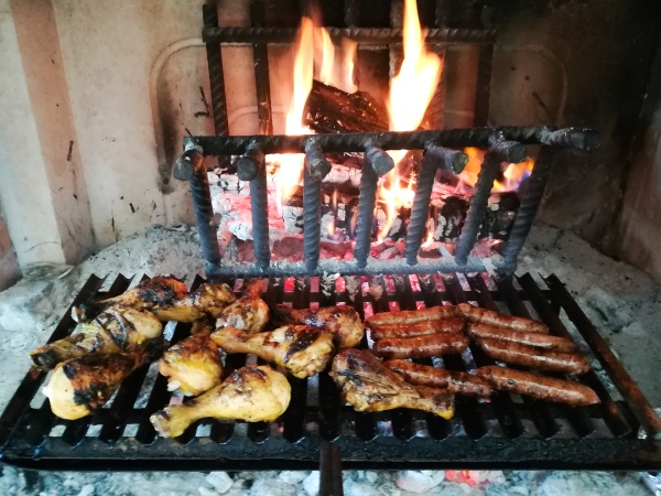 grilled meat on fireplace