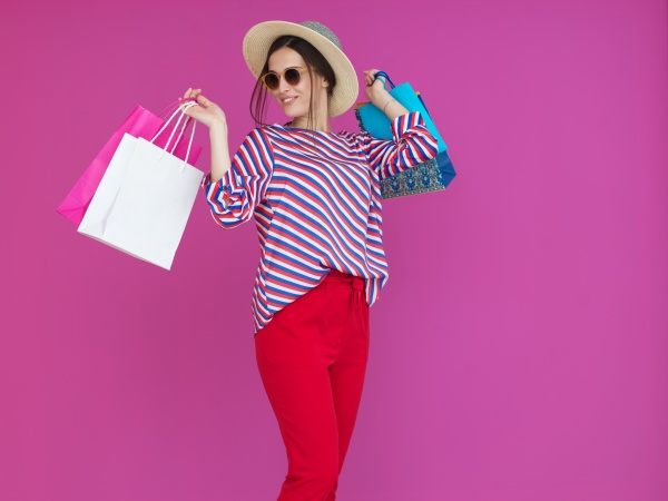 young woman with shopping bags on