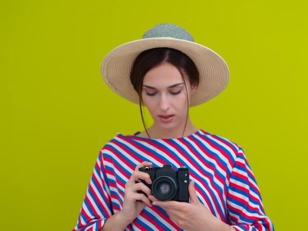 portrait of beautiful female photographer close