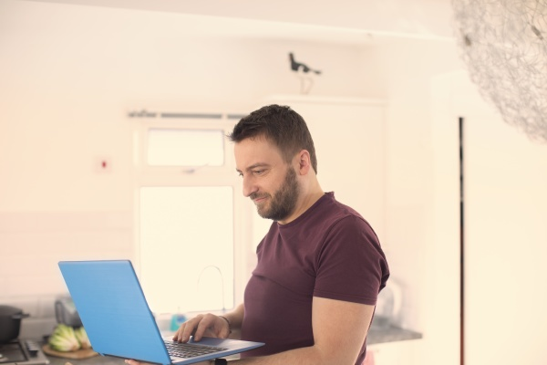 man working from home at laptop