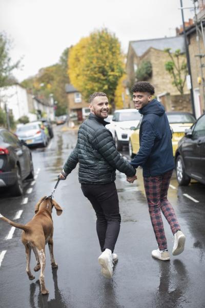 portrait happy gay male couple walking
