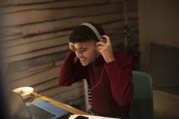 happy young man with headphones working