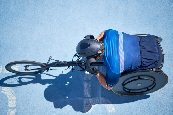 male wheelchair athlete on sunny blue