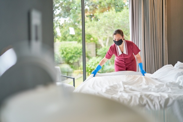 female hotel maid in face mask