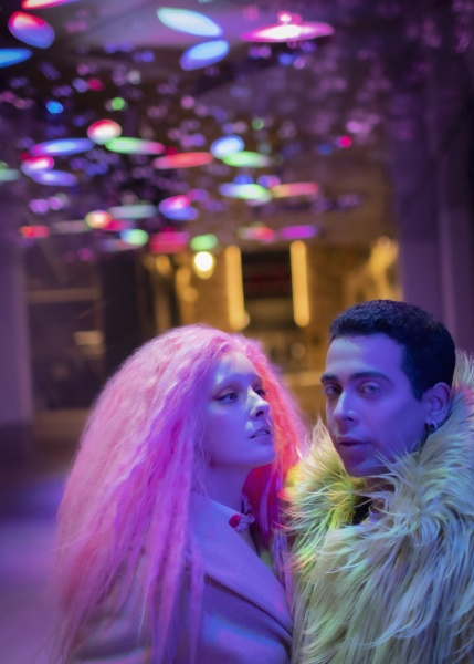 portrait cool fashionable couple under neon