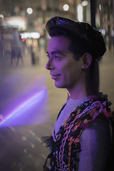eccentric young man on city sidewalk