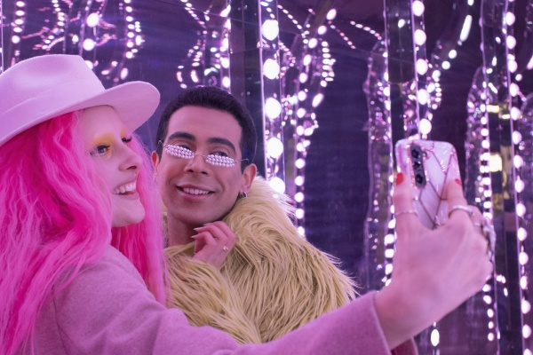 eccentric fashionable couple taking selfie with