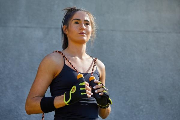 portrait confident female athlete with jump