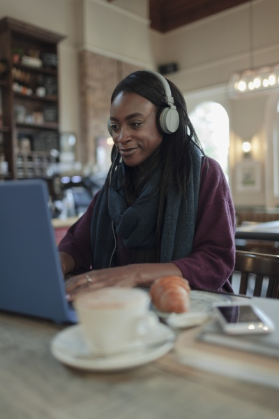young woman with headphones working at