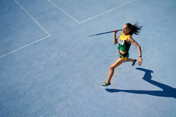 female track and field athlete throwing