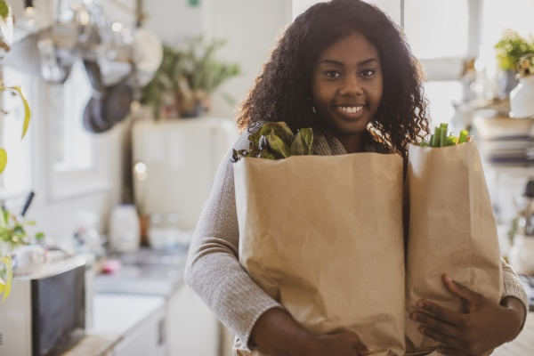portrait young woman with groceries in