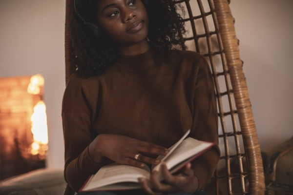 thoughtful, young, woman, reading, book, in - 30221647