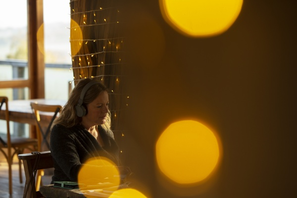 businesswoman with headphones working in cafe