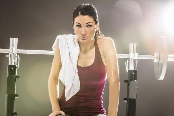 studio portrait of woman in sleeveless